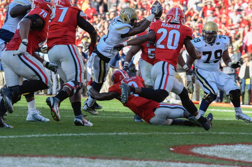Nov 26, 2016; Athens, GA, USA; Georgia Tech Yellow Jackets running back Qua Searcy (1) jumps for the go ahead touchdown against the Georgia Bulldogs during the fourth quarter at Sanford Stadium. Georgia Tech defeated Georgia 28-27. Mandatory Credit: Dale Zanine-USA TODAY Sports