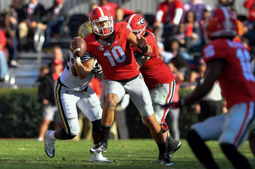Nov 26, 2016; Athens, GA, USA; Georgia Bulldogs quarterback Jacob Eason (10) tries to pass under pressure from the Georgia Tech Yellow Jackets during the second half at Sanford Stadium. Georgia Tech defeated Georgia 28-27. Mandatory Credit: Dale Zanine-USA TODAY Sports