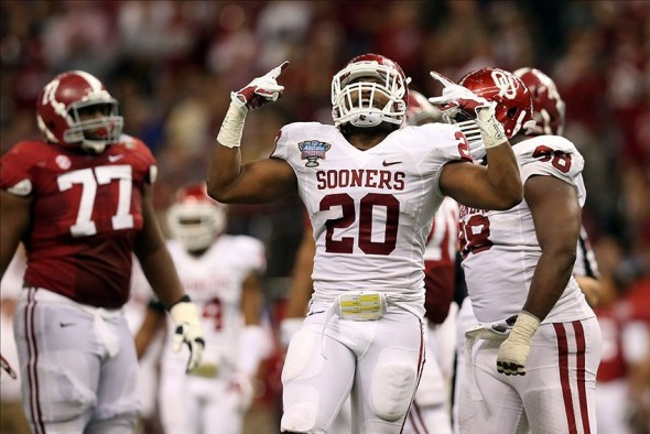 Jan 2, 2014; New Orleans, LA, USA; Oklahoma Sooners linebacker Frank Shannon (20) celebrates a sack against the Alabama Crimson Tide in the second half at the Mercedes-Benz Superdome. Oklahoma defeated Alabama 45-31. Mandatory Credit: Crystal LoGiudice-USA TODAY Sports