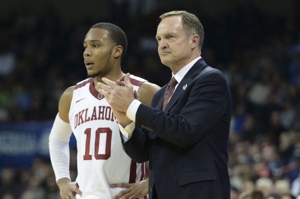 Mar 20, 2014; Spokane, WA, USA; Oklahoma Sooners head coach Lon Kruger (right) claps next to guard Jordan Woodard (10) against the North Dakota State Bison in the second half of a men