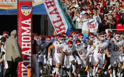 Dec 31, 2015; Miami Gardens, FL, USA; The Oklahoma Sooners run out for the start of the 2015 CFP Semifinal against the Clemson Tigers at the Orange Bowl at Sun Life Stadium. Mandatory Credit: Kim Klement-USA TODAY Sports