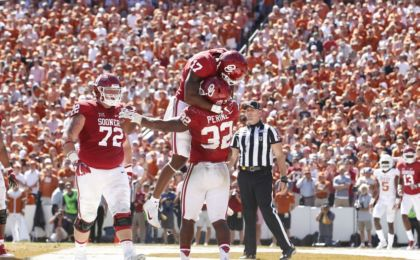 Oct 8, 2016; Dallas, TX, USA;  Oklahoma Sooners running back Samaje Perine (32) and wide receiver Jordan Smallwood (17) and offensive lineman Ben Powers (72) celebrate a touchdown in the fourth quarter against the Texas Longhorns at Cotton Bowl. Oklahoma won 45-40. Mandatory Credit: Tim Heitman-USA TODAY Sports
