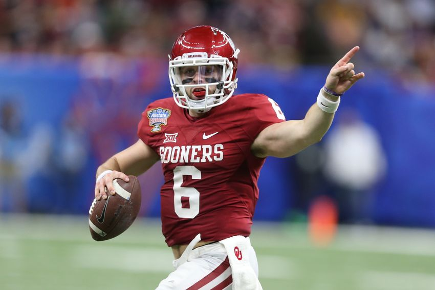 Jan 2, 2017; New Orleans , LA, USA; Oklahoma Sooners quarterback Baker Mayfield (6) signals to a receiver against the Auburn Tigers in the second quarter of the 2017 Sugar Bowl at the Mercedes-Benz Superdome. Mandatory Credit: Chuck Cook-USA TODAY Sports
