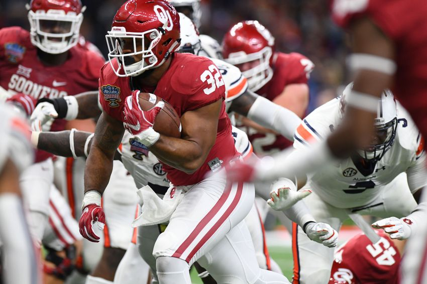 Jan 2, 2017; New Orleans , LA, USA; Oklahoma Sooners running back Samaje Perine (32) carries the ball for a touchdown against the Auburn Tigers in the fourth quarter of the 2017 Sugar Bowl at the Mercedes-Benz Superdome. Mandatory Credit: John David Mercer-USA TODAY Sports