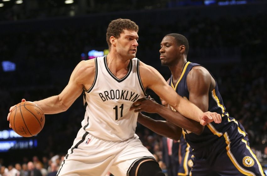 Mar 26, 2016; Brooklyn, NY, USA; Brooklyn Nets center Brook Lopez (11) drives against Indiana Pacers center Ian Mahinmi (28) during the third quarter at Barclays Center. Brooklyn Nets won 120-110. Mandatory Credit: Anthony Gruppuso-USA TODAY Sports