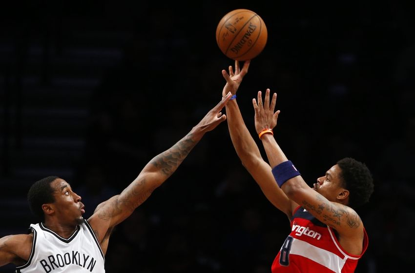 Apr 11, 2016; Brooklyn, NY, USA; Brooklyn Nets guard Rondae Hollis-Jefferson (24) defends against Washington Wizards guard Jarell Eddie (8) during second half at Barclays Center. The Washington Wizards defeated the Brooklyn Nets 120-111. Mandatory Credit: Noah K. Murray-USA TODAY Sports