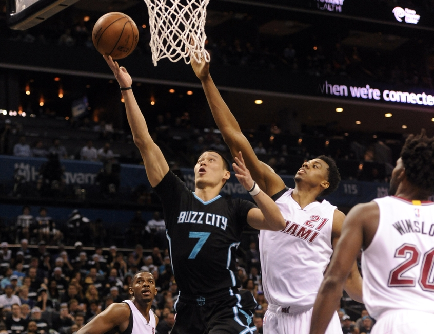 9265532-hassan-whiteside-jeremy-lin-nba-playoffs-miami-heat-charlotte-hornets