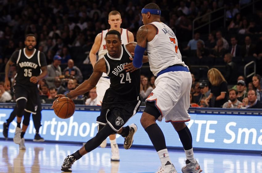 Oct 8, 2016; New York, NY, USA; Brooklyn Nets guard Rondae Hollis-Jefferson (24) drives to the basket past New York Knicks forward Carmelo Anthony (7) during the second half at Madison Square Garden. Mandatory Credit: Adam Hunger-USA TODAY Sports
