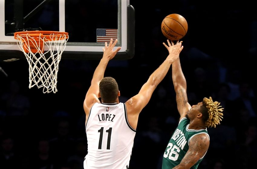 Oct 13, 2016; Brooklyn, NY, USA; Brooklyn Nets center Brook Lopez 911) defends against Boston Celtics guard Marcus Smart (36) as he goes up for a shot during a preseason game during the first half at Barclays Center. Mandatory Credit: Andy Marlin-USA TODAY Sports