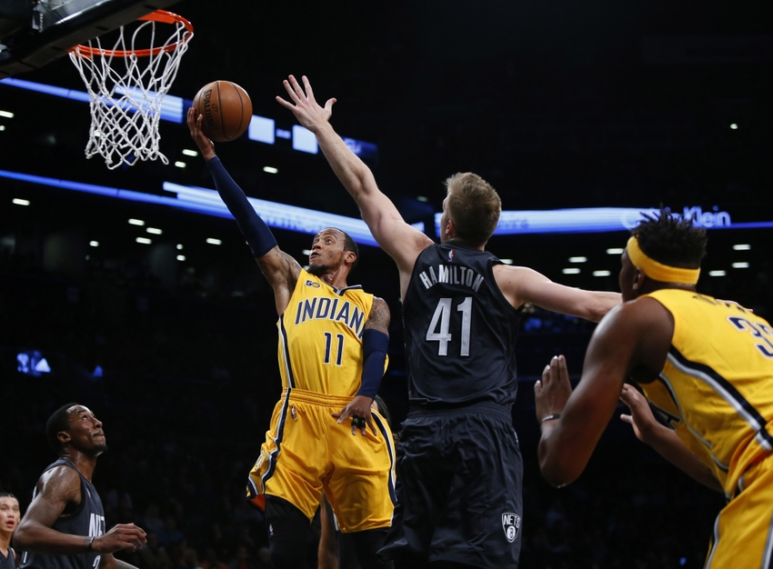 Oct 28, 2016; Brooklyn, NY, USA; Indiana Pacers guard Monta Ellis (11) shoots the ball in front of Brooklyn Nets forward Justin Hamilton (41) during first half at Barclays Center. Mandatory Credit: Noah K. Murray-USA TODAY Sports