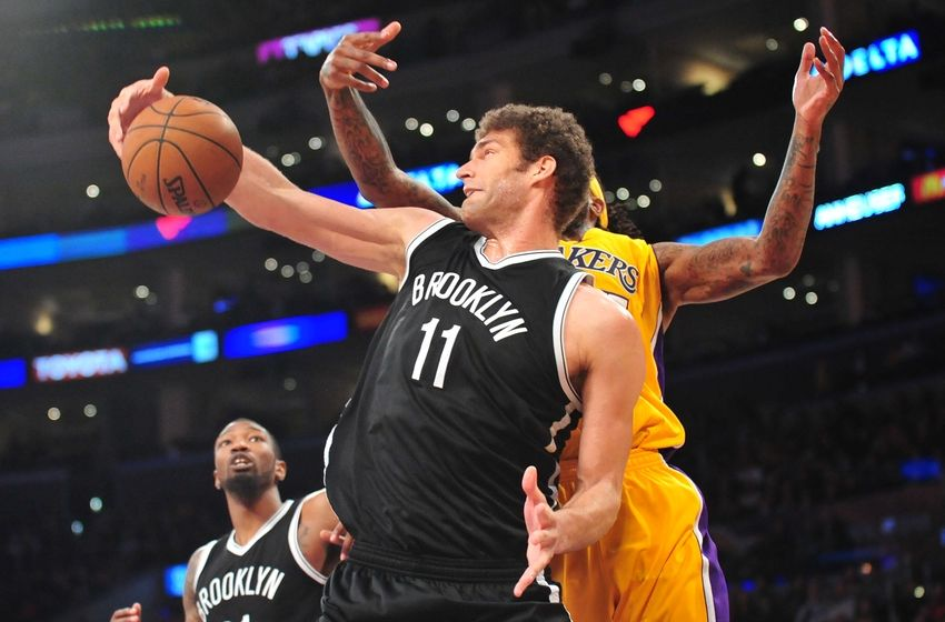 February 20, 2015; Los Angeles, CA, USA; Brooklyn Nets center Brook Lopez (11) grabs a rebound against the Los Angeles Lakers during the second half at Staples Center. Mandatory Credit: Gary A. Vasquez-USA TODAY Sports