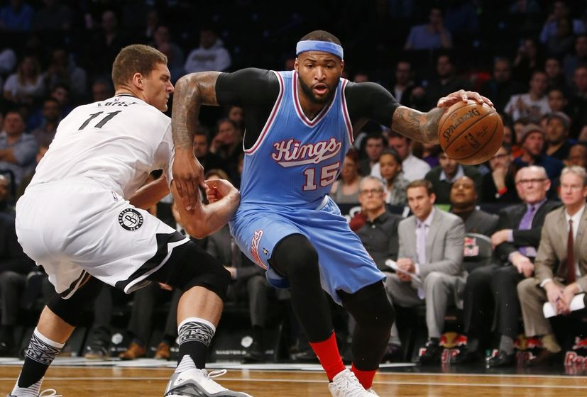 Feb 5, 2016; Brooklyn, NY, USA; Sacramento Kings center DeMarcus Cousins (15) drives to the basket against Brooklyn Nets center Brook Lopez (11) during the first half at Barclays Center. Mandatory Credit: Noah K. Murray-USA TODAY Sports