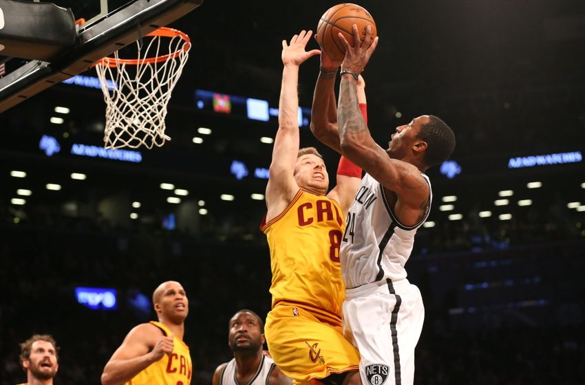 Mar 24, 2016; Brooklyn, NY, USA; Brooklyn Nets guard Rondae Hollis-Jefferson (24) shoots over Cleveland Cavaliers guard Matthew Dellavedova (8) during the fourth quarter at Barclays Center. Brooklyn won 104-95. Mandatory Credit: Anthony Gruppuso-USA TODAY Sports