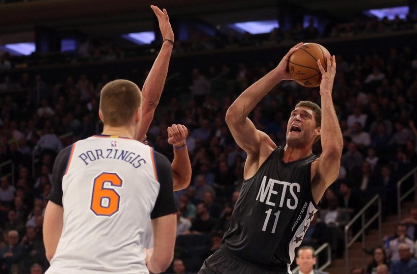 Nov 9, 2016; New York, NY, USA; Brooklyn Nets center Brook Lopez (11) shoots against New York Knicks center Joakim Noah (13) and New York Knicks power forward Kristaps Porzingis (6) during the second quarter at Madison Square Garden. Mandatory Credit: Brad Penner-USA TODAY Sports