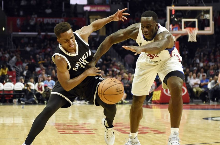 Nov 14, 2016; Los Angeles, CA, USA; Brooklyn Nets guard Yogi Ferrell (10) battles for the ball with Los Angeles Clippers forward Brandon Bass (30)  in the second half of a NBA basketball game at Staples Center. Mandatory Credit: Richard Mackson-USA TODAY Sports