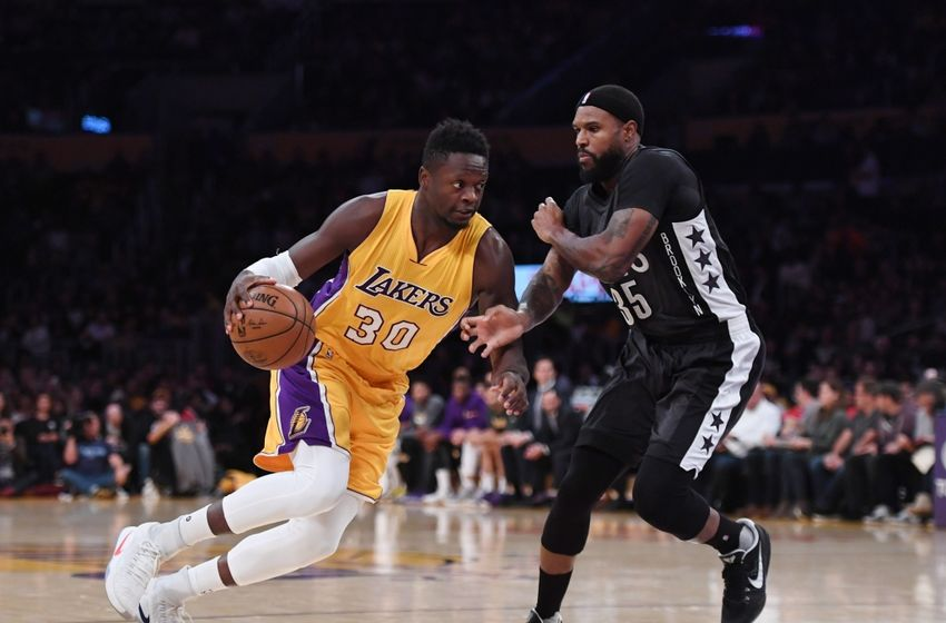 Nov 15, 2016; Los Angeles, CA, USA; Los Angeles Lakers forward Julius Randle (30) is defended by Brooklyn Nets forward Trevor Booker (35) during a NBA basketball game at Staples Center. Mandatory Credit: Kirby Lee-USA TODAY Sports