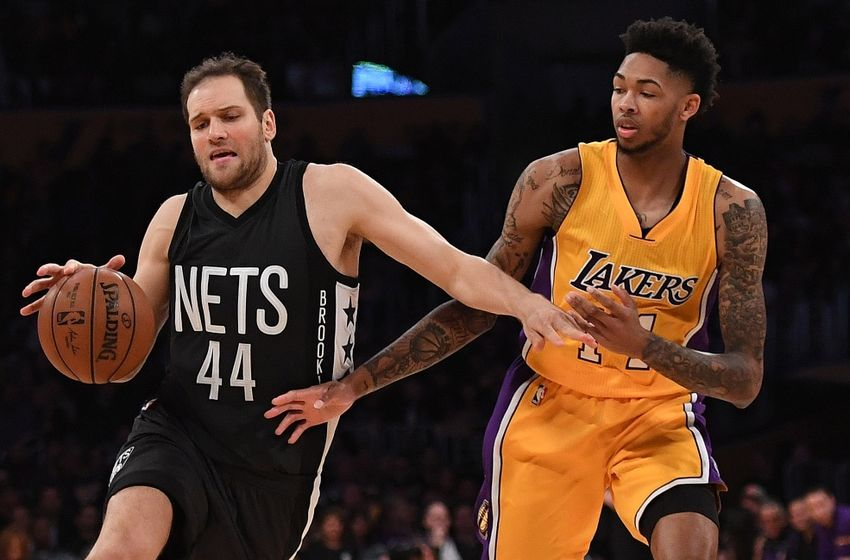 Nov 15, 2016; Los Angeles, CA, USA; Brooklyn Nets guard Bojan Bogdanovic (44) is fouled by Los Angeles Lakers forward Brandon Ingram (14) during a NBA basketball game at Staples Center. The Lakers defeated the Nets 125-118. Mandatory Credit: Kirby Lee-USA TODAY Sports