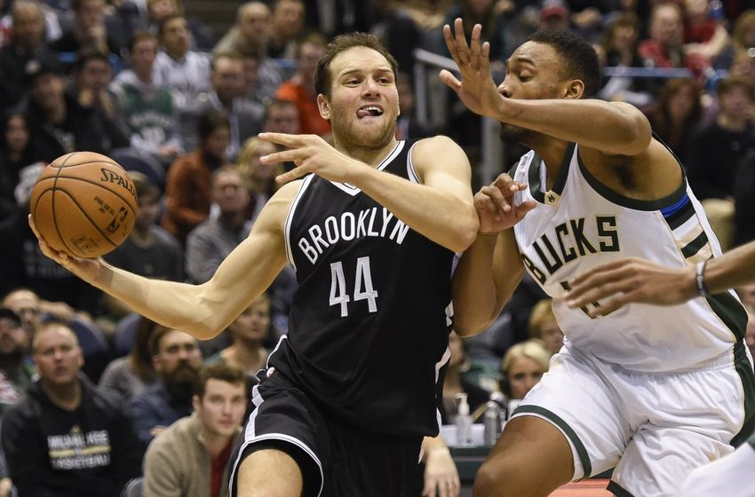 Dec 3, 2016; Milwaukee, WI, USA; Brooklyn Nets guard Bojan Bogdanovic (44) drives for the basket against Milwaukee Bucks forward Jabari Parker (12) in the fourth quarter at BMO Harris Bradley Center. Mandatory Credit: Benny Sieu-USA TODAY Sports