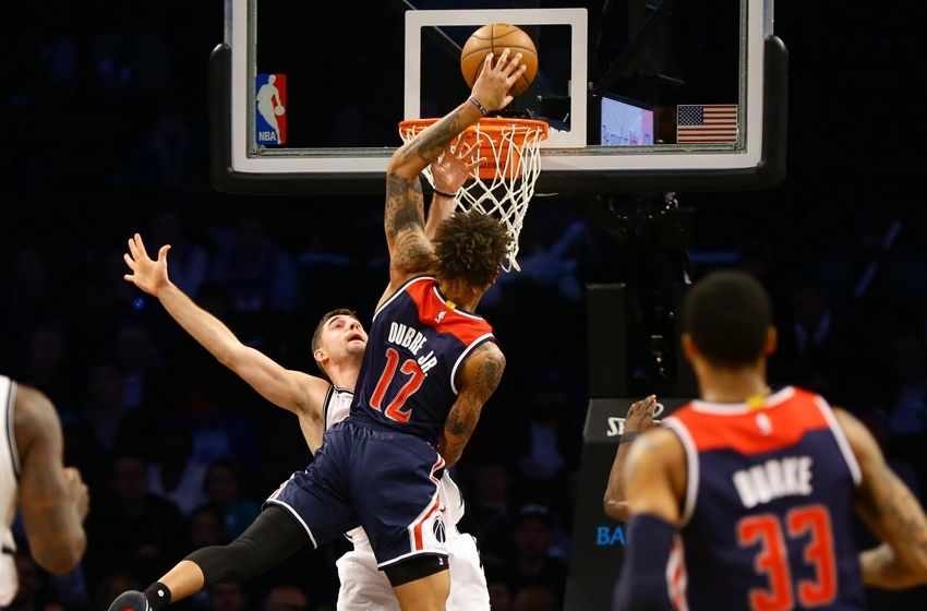 Dec 5, 2016; Brooklyn, NY, USA; Washington Wizards forward Kelly Oubre Jr. (12) goes up for a shot over  Brooklyn Nets guard Jie Harris (12) during the second half at Barclays Center. The Wizards won 118-113. Mandatory Credit: Andy Marlin-USA TODAY Sports