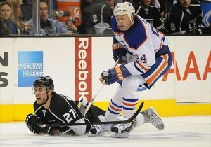 NHL: Edmonton Oilers at Los Angeles Kings April 2, 2012; Los Angeles, CA, USA; Edmonton Oilers left wing Ryan Smyth (94) and Los Angeles Kings defenseman Alec Martinez (27) chase down the puck in the second period of the game at the Staples Center. Mandatory Credit: Jayne Kamin-Oncea-USA TODAY Sports