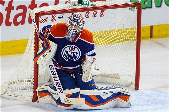 NHL: Winnipeg Jets at Edmonton OilersOct 1, 2013; Edmonton, Alberta, CAN; Edmonton Oilers goalie Devan Dubnyk (40) makes a save against the Winnipeg Jets during the first period at Rexall Place. Mandatory Credit: Sergei Belski-USA TODAY Sports