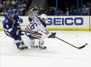 NHL: Edmonton Oilers at Tampa Bay LightningNov 7, 2013; Tampa, FL, USA; Edmonton Oilers center Mark Arcobello (26) skates with the puck as Tampa Bay Lightning center Tyler Johnson (9) defends during the first period at Tampa Bay Times Forum. Mandatory Credit: Kim Klement-USA TODAY Sports