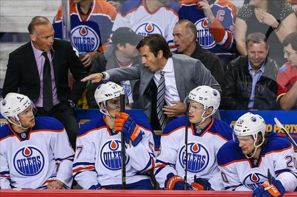 NHL: Edmonton Oilers at Calgary FlamesNov 16, 2013; Calgary, Alberta, CAN; Edmonton Oilers head coach Dallas Eakins on his bench during the third period against the Calgary Flames at Scotiabank Saddledome. Edmonton Oilers won 4-2. Mandatory Credit: Sergei Belski-USA TODAY Sports