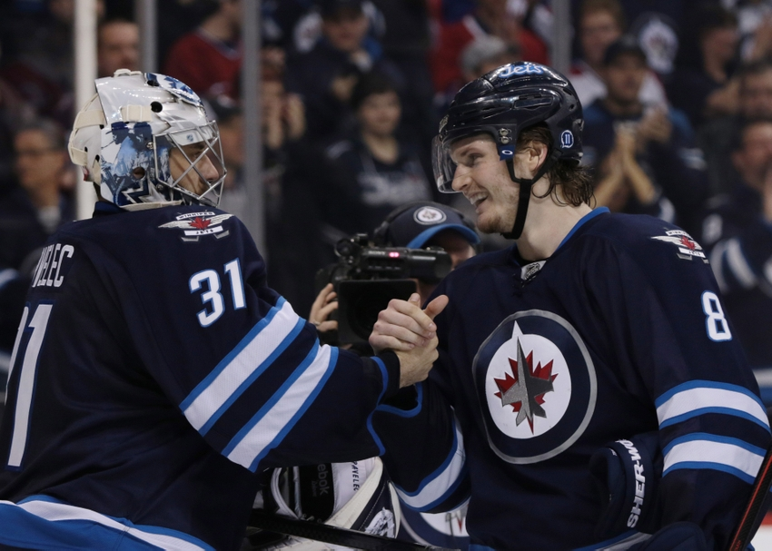 8477144-ondrej-pavelec-jacob-trouba-nhl-montreal-canadiens-winnipeg-jets