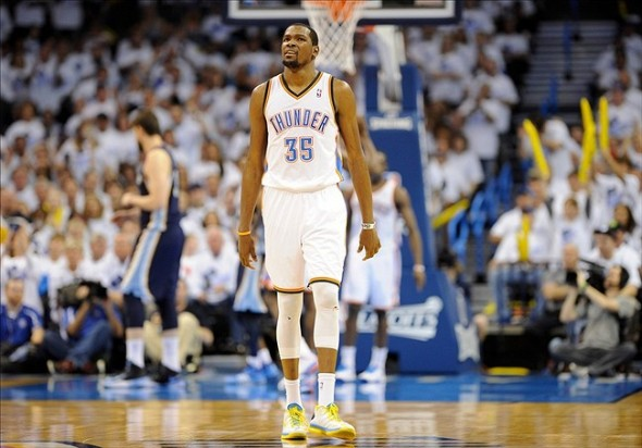 May 15, 2013; Oklahoma City, OK, USA; Oklahoma City Thunder small forward Kevin Durant (35) reacts after missing a shot against the Memphis Grizzlies during the second half of game five of the second round of the 2013 NBA Playoffs at Chesapeake Energy Arena. The Grizzlies defeated the Thunder 88-84. Mandatory Credit: Jerome Miron-USA TODAY Sports