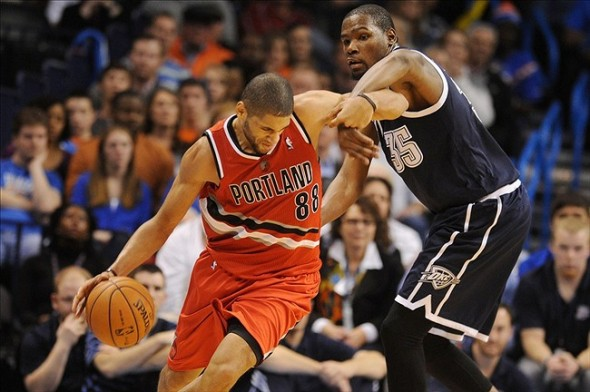 Dec 31, 2013; Oklahoma City, OK, USA; Portland Trail Blazers small forward Nicolas Batum (88) handles the ball while being guarded by Oklahoma City Thunder small forward Kevin Durant (35) during the fourth quarter at Chesapeake Energy Arena. Mandatory Credit: Mark D. Smith-USA TODAY Sports