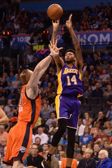 Oct 30, 2016; Oklahoma City, OK, USA; Los Angeles Lakers forward Brandon Ingram (14) shoots the ball over Oklahoma City Thunder forward Kyle Singler (15) during the second quarter at Chesapeake Energy Arena. Mandatory Credit: Mark D. Smith-USA TODAY Sports