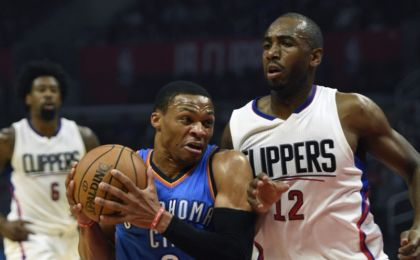 Nov 2, 2016; Los Angeles, CA, USA; Oklahoma City Thunder guard Russell Westbrook (0) drives the ball defended by Los Angeles Clippers forward Luc Mbah a Moute (12) during the first quarter at Staples Center. Mandatory Credit: Kelvin Kuo-USA TODAY Sports