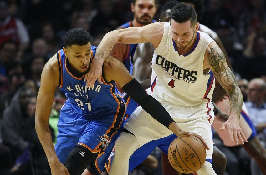 Nov 2, 2016; Los Angeles, CA, USA; Oklahoma City Thunder guard Andre Roberson (21) steals the ball from Los Angeles Clippers guard JJ Redick (4) during the second quarter at Staples Center. Mandatory Credit: Kelvin Kuo-USA TODAY Sports