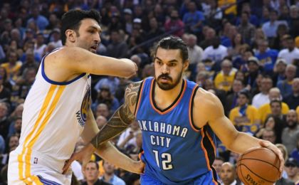 November 3, 2016; Oakland, CA, USA; Oklahoma City Thunder center Steven Adams (12) dribbles the ball against Golden State Warriors center Zaza Pachulia (27) during the first quarter at Oracle Arena. Mandatory Credit: Kyle Terada-USA TODAY Sports