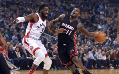 Nov 4, 2016; Toronto, Ontario, CAN;  Miami Heat guard Dion Waiters (11) tries to get past Toronto Raptors forward DeMarre Carroll (5) in the first half at Air Canada Centre. Mandatory Credit: Dan Hamilton-USA TODAY Sports