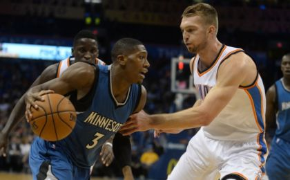 Nov 5, 2016; Oklahoma City, OK, USA; Minnesota Timberwolves guard Kris Dunn (3) drives to the basket against Oklahoma City Thunder forward Domantas Sabonis (3) during the first quarter at Chesapeake Energy Arena. Mandatory Credit: Mark D. Smith-USA TODAY Sports
