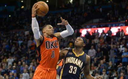 Nov 20, 2016; Oklahoma City, OK, USA; Oklahoma City Thunder guard Russell Westbrook (0) drives to the basket against Indiana Pacers center Myles Turner (33) during the fourth quarter at Chesapeake Energy Arena. Mandatory Credit: Mark D. Smith-USA TODAY Sports