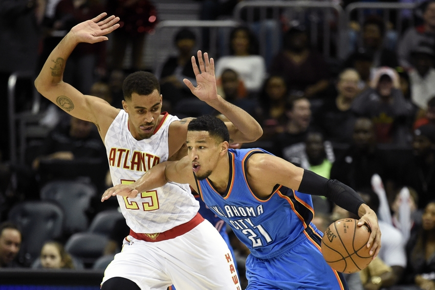 Nov 30, 2015; Atlanta, GA, USA; Oklahoma City Thunder guard Andre Roberson (21) dribbles past Atlanta Hawks guard Thabo Sefolosha (25) during the first half at Philips Arena. Mandatory Credit: Dale Zanine-USA TODAY Sports