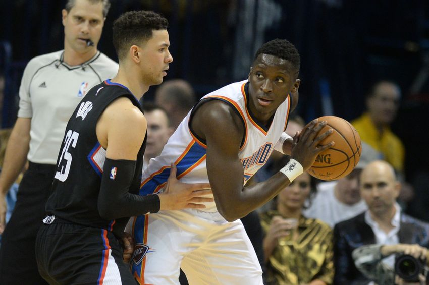Dec 31, 2016; Oklahoma City, OK, USA; Oklahoma City Thunder guard Victor Oladipo (5) handles the ball against LA Clippers guard Austin Rivers (25) during the first quarter at Chesapeake Energy Arena. Mandatory Credit: Mark D. Smith-USA TODAY Sports