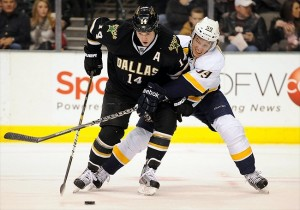Jamie Benn fights off Nashville Predators defenseman Roman Josi
