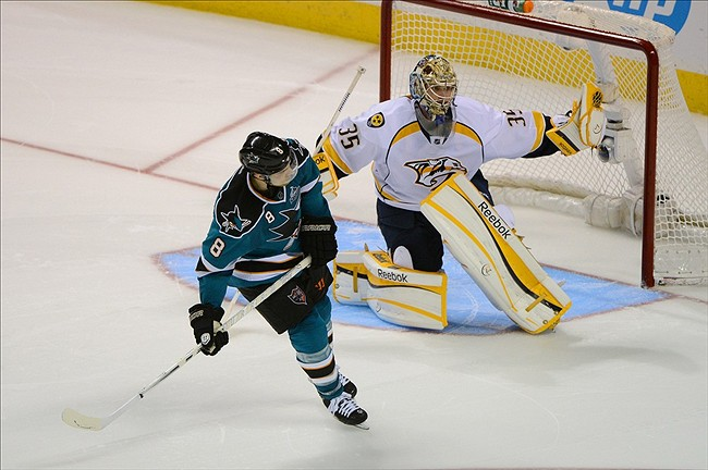 Nashville Predators goalie Pekka Rinne ends a shootout victory against San Jose