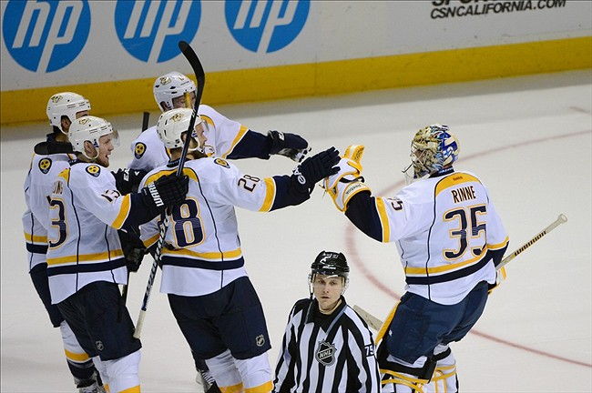 The Nashville Predators congratulate goalie Pekka Rinne on a shootout win