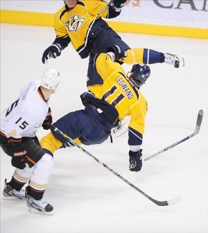 Nashville Predators center David Legwand collides with a teammate