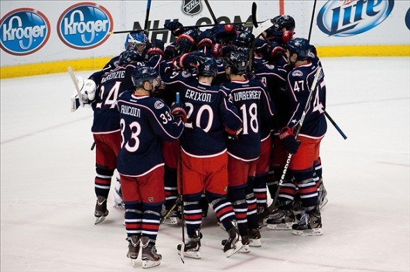 The Columbus Blue Jackets celebrate a win over the Detroit red Wings