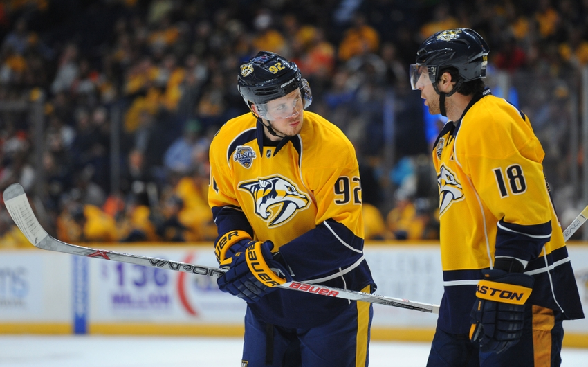 Feb 4, 2016; Nashville, TN, USA; Nashville Predators center Ryan Johansen (92) talks with right winger James Neal (18) during the first period against the Philadelphia Flyers at Bridgestone Arena. Mandatory Credit: Christopher Hanewinckel-USA TODAY Sports