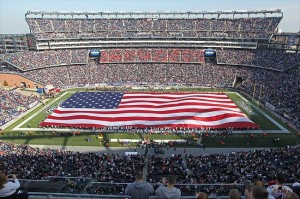 Nov 11, 2012; Foxborough, MA, USA; A huge America flag is unfurled during the National Anthem prior to the start of a game between the Buffalo Bills and New England Patriots at Gillette Stadium. Mandatory Credit: Stew Milne-USA TODAY Sports