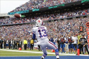 Sep 15, 2013; Orchard Park, NY, USA; Buffalo Bills wide receiver Steve Johnson (13) catches a touchdown pass with 2 seconds left in the game to beat the Carolina Panthers at Ralph Wilson Stadium. Mandatory Credit: Kevin Hoffman-USA TODAY Sports