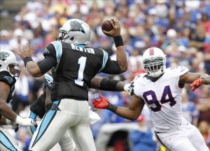 Sep 15, 2013; Orchard Park, NY, USA; Carolina Panthers quarterback Cam Newton (1) passes under pressure by Buffalo Bills defensive end Mario Williams (94) during the second half at Ralph Wilson Stadium. Buffalo beat Carolina 27-26. Mandatory Credit: Kevin Hoffman-USA TODAY Sports