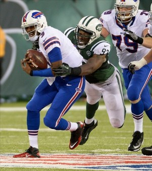 Sep 22, 2013; East Rutherford, NJ, USA; Buffalo Bills quarterback EJ Manuel (3) is sacked by New York Jets outside linebacker Calvin Pace (97) at MetLife Stadium. Mandatory Credit: Robert Deutsch-USA TODAY Sports