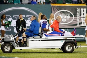 Sep 22, 2013; East Rutherford, NJ, USA; Buffalo Bills defensive end Alex Carrington (92) leaves the field on a cart during the fourth quarter against the New York Jets at MetLife Stadium. Mandatory Credit: Anthony Gruppuso-USA TODAY Sports